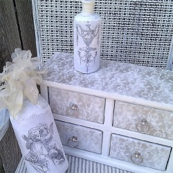 Transform old furniture with lace and spray