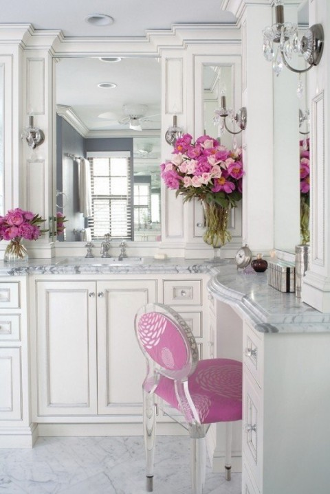 Elegant marble bathroom with pink touches1