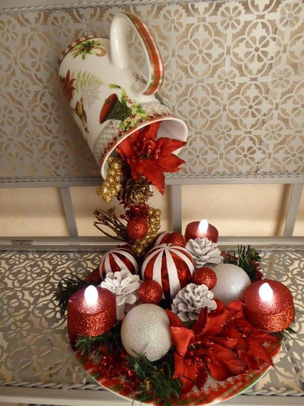 Christmas decorations with ornaments spilled from cups (2)