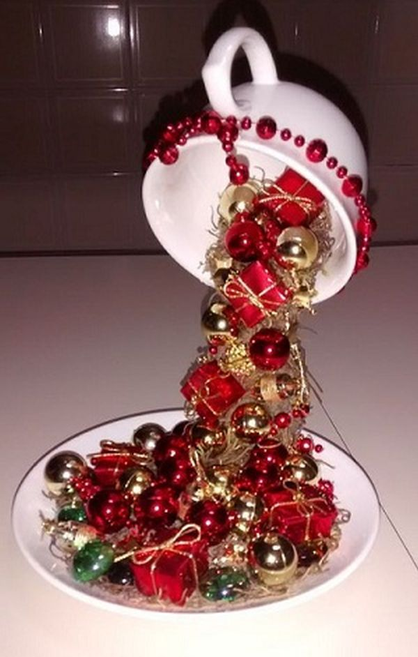 Christmas decorations with ornaments spilled from cups (3)